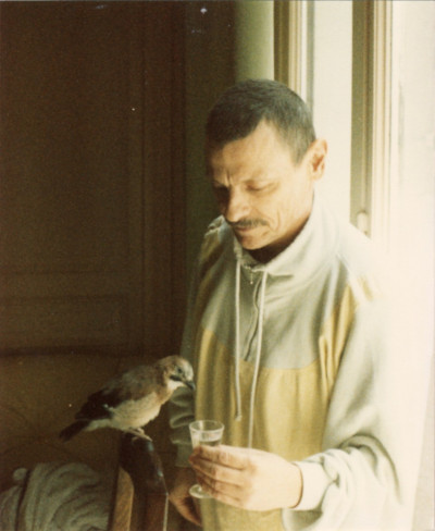 Andrei Tarkovsky with Tishka, an injured bird adopted by his family. 8 June 1986. Photograph © Irina Brown 1986.